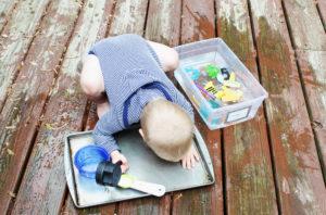baby playing with splash pan