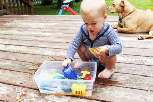 playing with water sensory bin