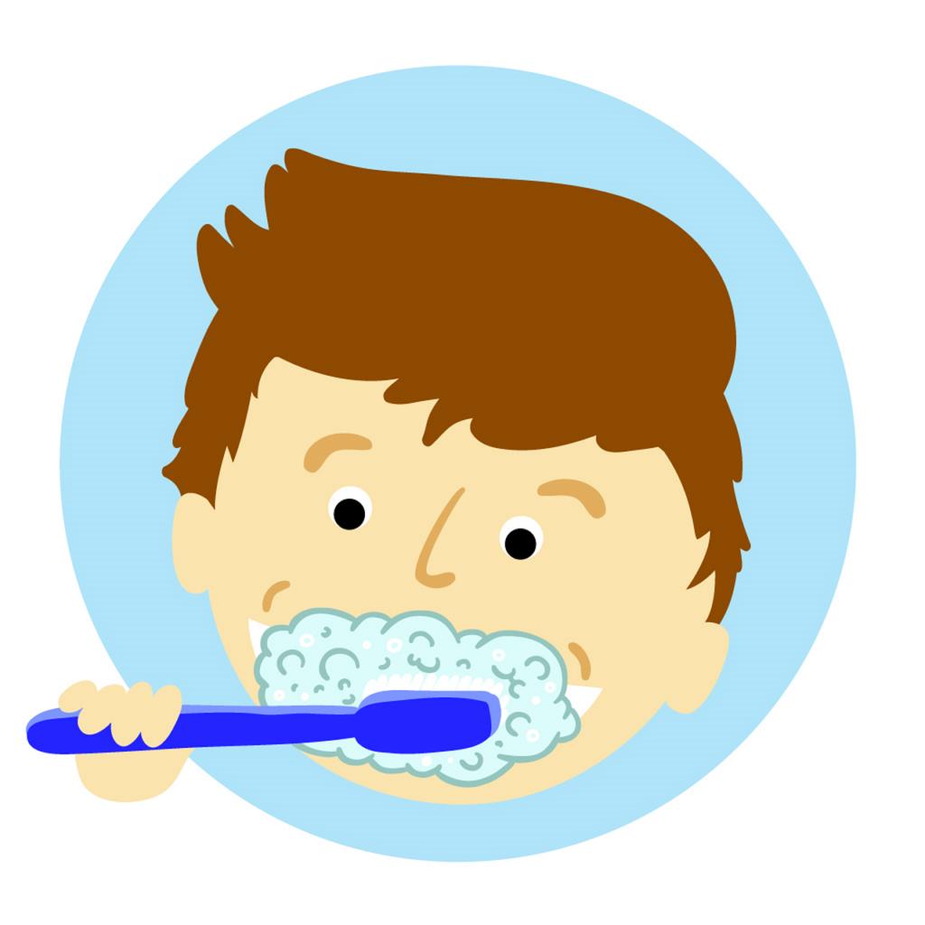 boy with toothbrush brushing his toddler teeth