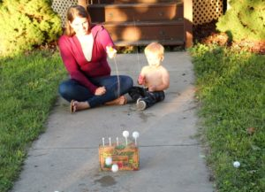 mom and son playing water pistol game 1