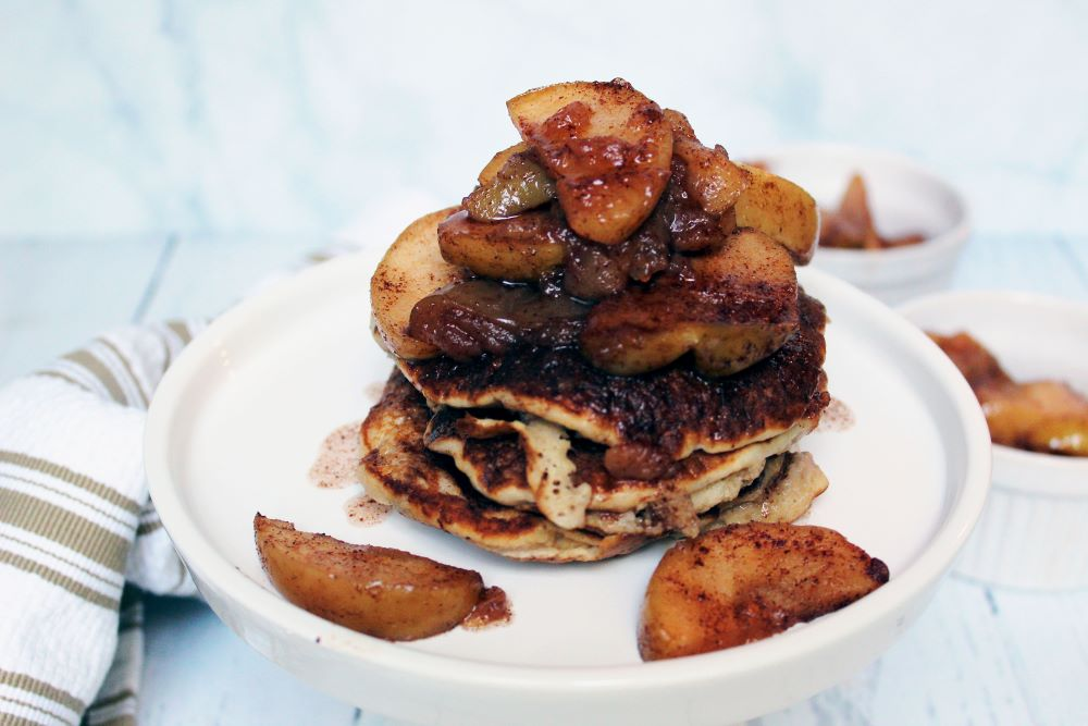pancakes on cake stand topped with cinnamon apples 1