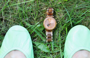 shoes grass and watch