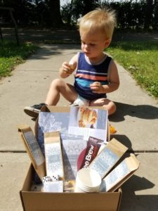 toddler with date night in box display