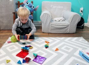 boy playing with picassotiles steam stem toy 1