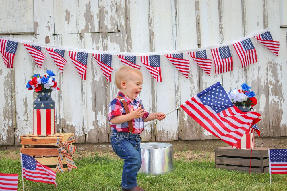 toddler with american flag