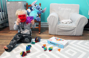 boy looking through picassotiles steam stem toy