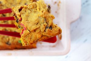 trail mix cookie bar on spatula above baking pan 1