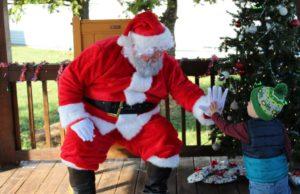 Camden high fiving Santa