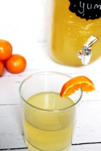 lemonade party punch in glass with glass pitcher and tangerines 1