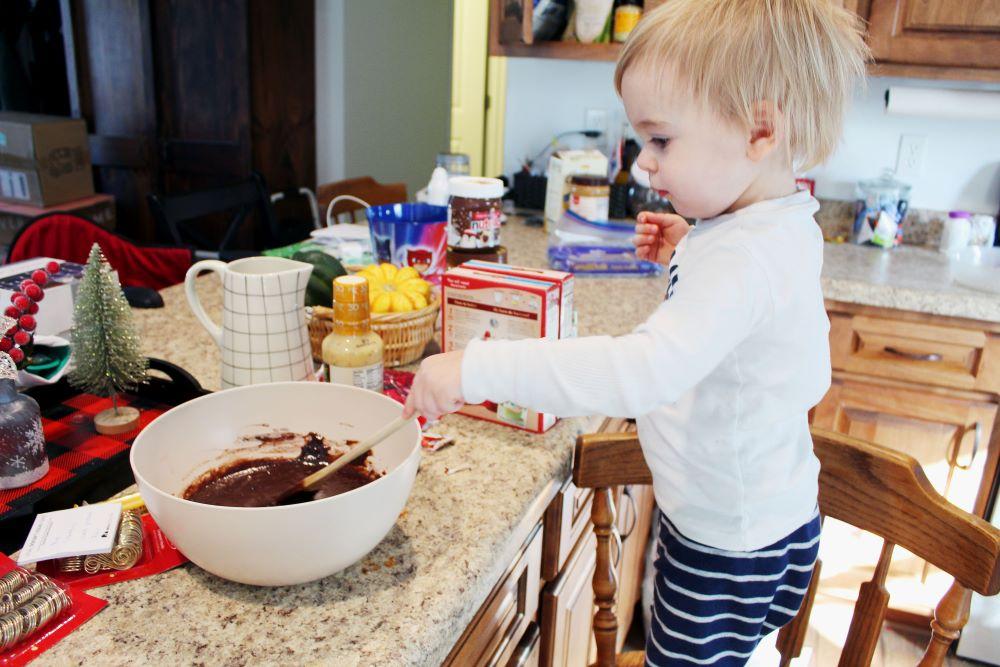 toddler stirring brownie mix 1