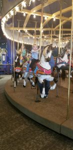 riding the carousel at indianapolis children's museum
