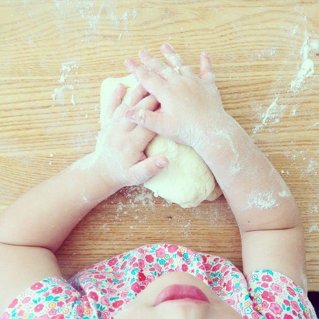 toddler helping cook