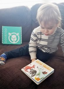 toddler holding bookroo book 1