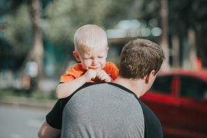 Canva - Man Carrying Child