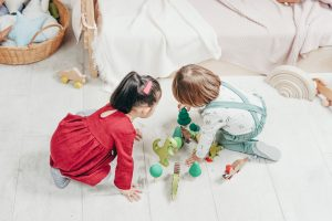 Canva - Toddlers playing