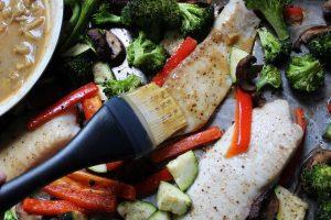 basting sheet pan fish with lemon garlic sauce 1