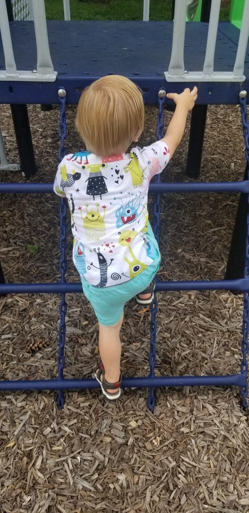 toddler climbing playground ladder