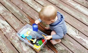 baby-playing-with-sensory-bin 1