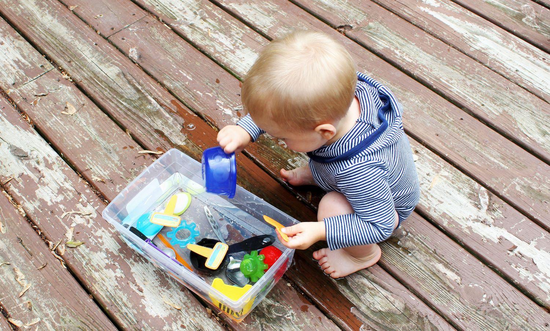 baby-playing-with-sensory-bin 1