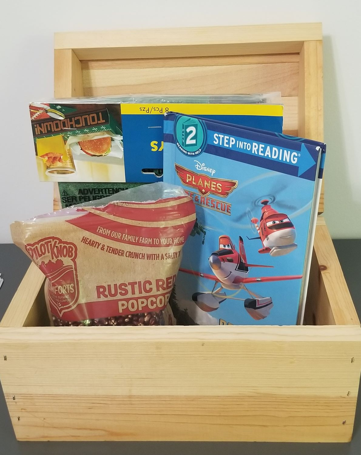 treasure chest with popcorn, book and movie night for homeschool preschool learning activities