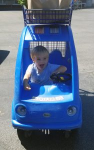 toddler in shopping cart at IGA