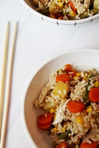 two bowls of slow cooker chicken fried rice