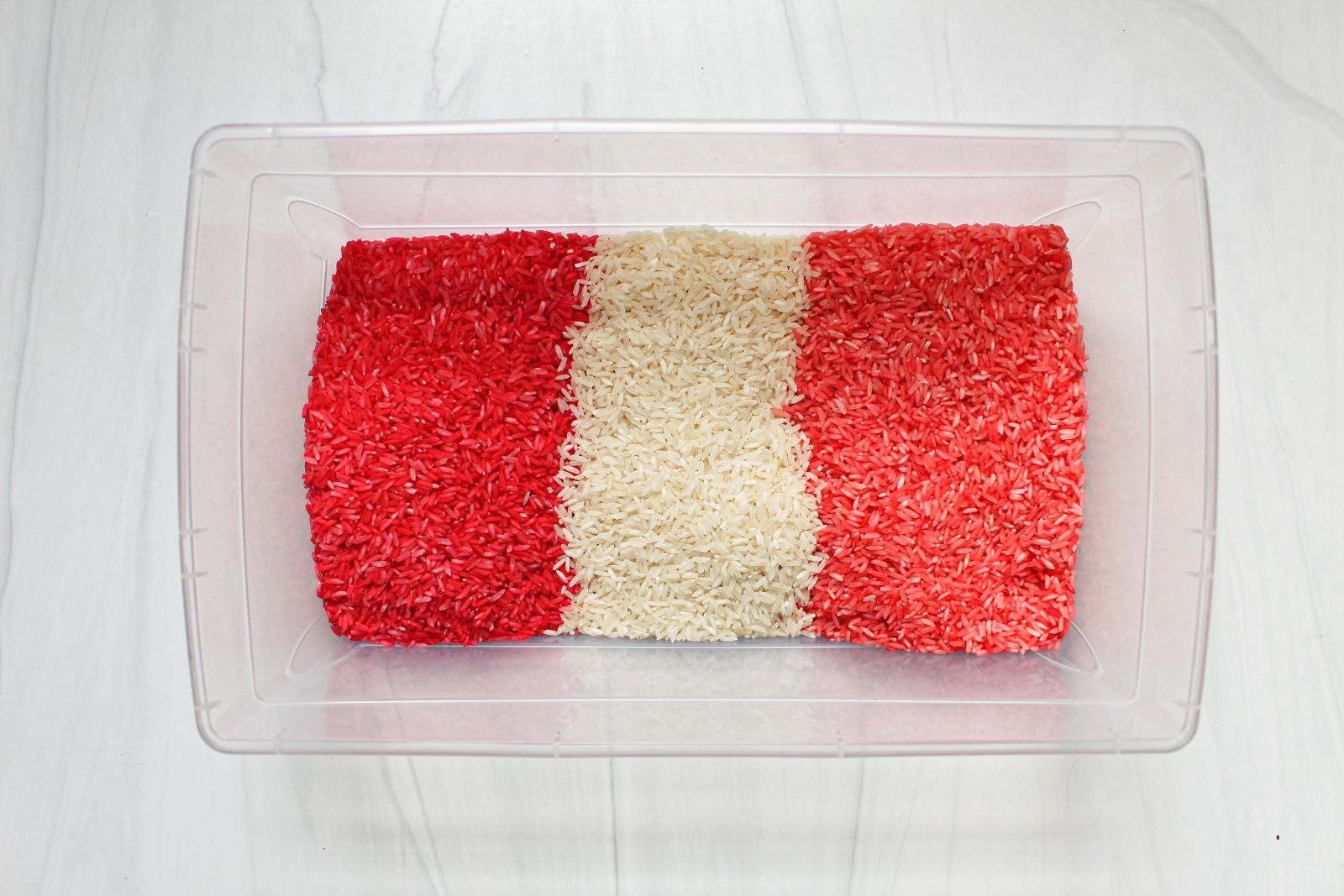 red white pink rice for valentine's day sensory bin 1