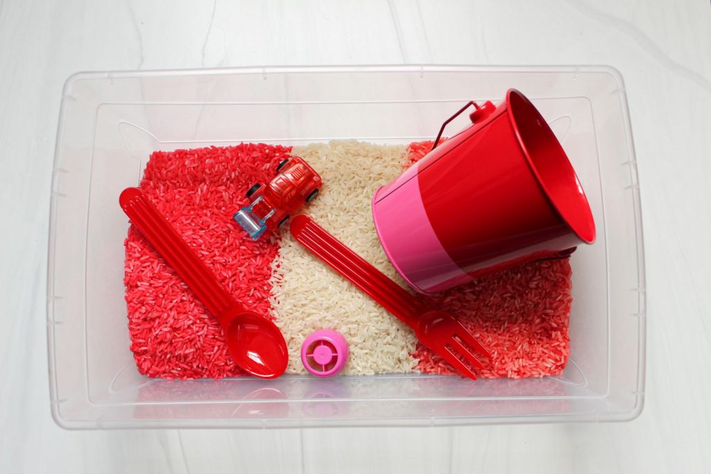 valentine's day rice sensory bin with toys 1