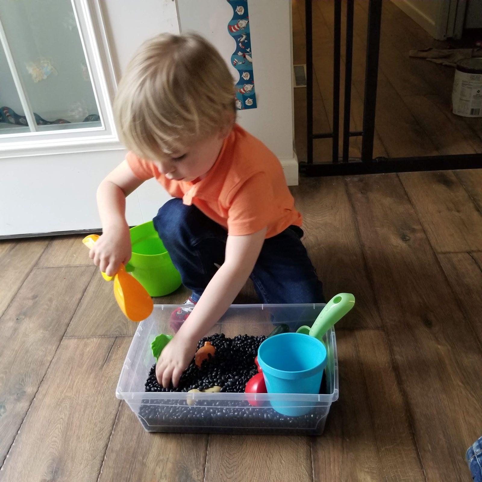 toddler digging in gendering bin