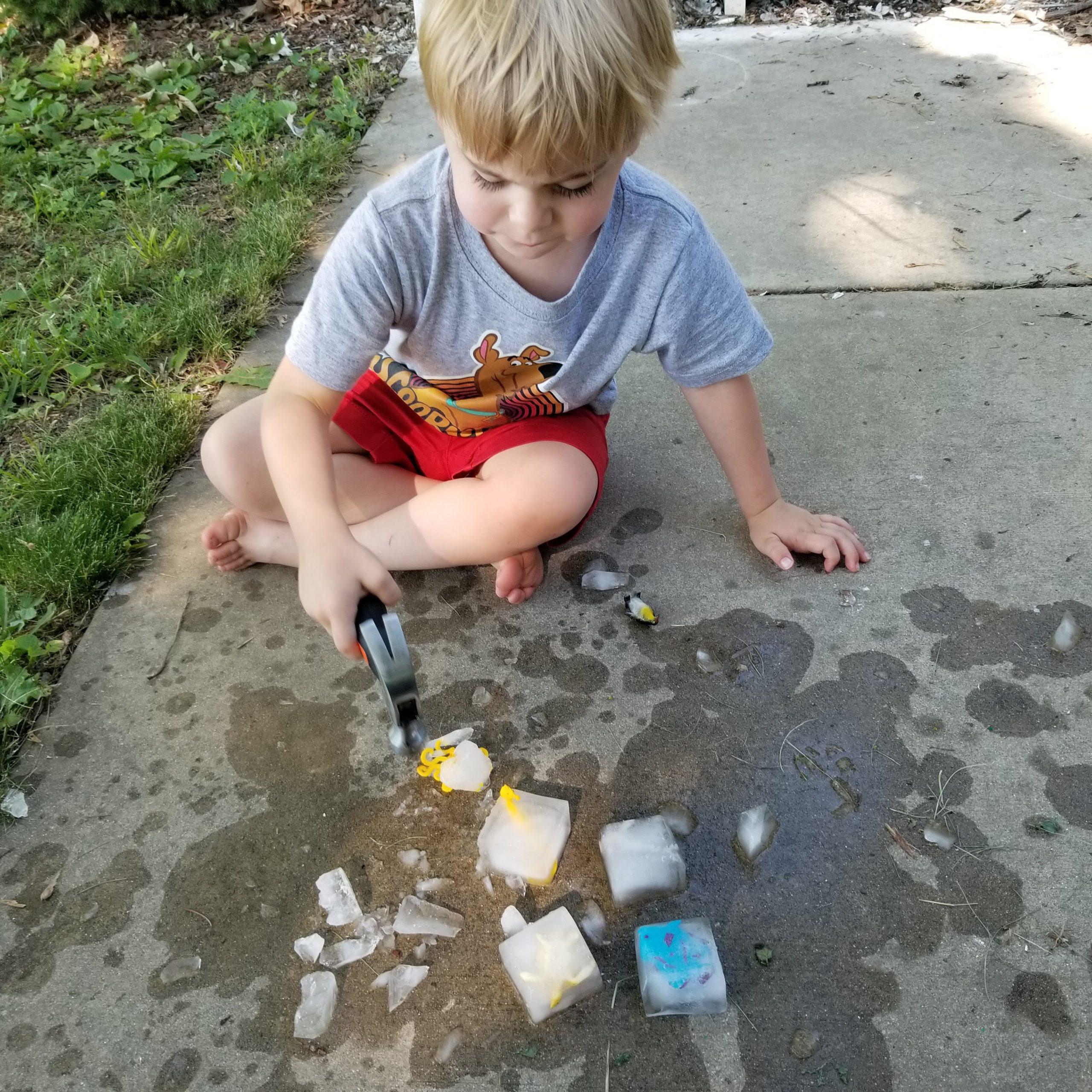 Toddler playing sensory ocean animal rescue activity